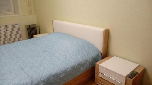 Кровать или кровати в номере Апаптаменты на Трехсвятской