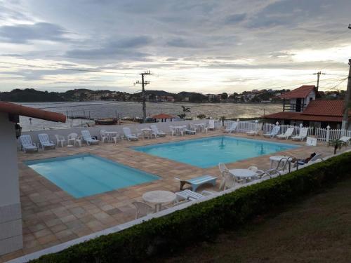 Uma vista da piscina em Cantinho do Village ou nos arredores