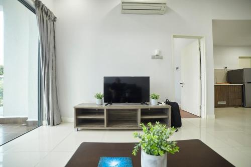 A television and/or entertainment centre at State Residences The Loft @ Imago Mall