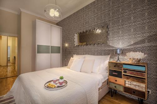 Letto o letti in una camera di Luxurious Apartments Ujezd