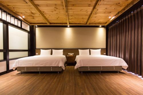 A bed or beds in a room at Sunlight-Horoyoi Homestay