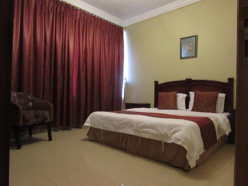 Cama ou camas em um quarto em Iwan Alandalusia Al Safa