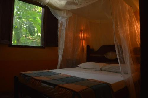 A bed or beds in a room at Zimbo Tropical