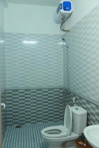 Phòng tắm tại Gold Plus Hotel