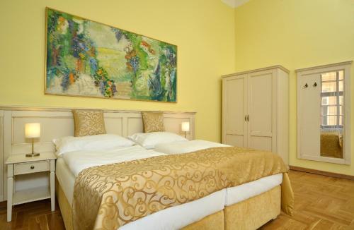 Кровать или кровати в номере Hotel Metamorphis