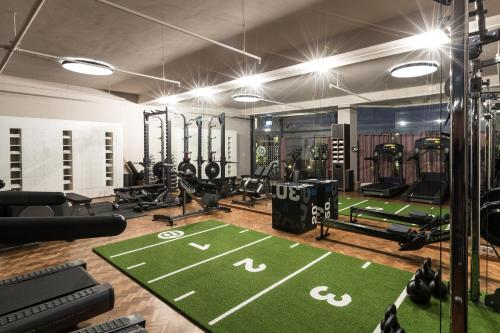 The fitness center and/or fitness facilities at CORTIINA Hotel