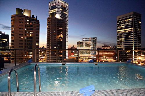 The swimming pool at or near Palladium Business Hotel