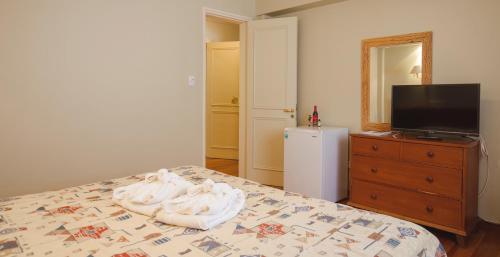 Una cama o camas en una habitación de Hotel Spa Termas de Reyes