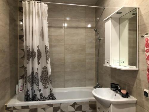 A bathroom at Апартаменты на Шахматной
