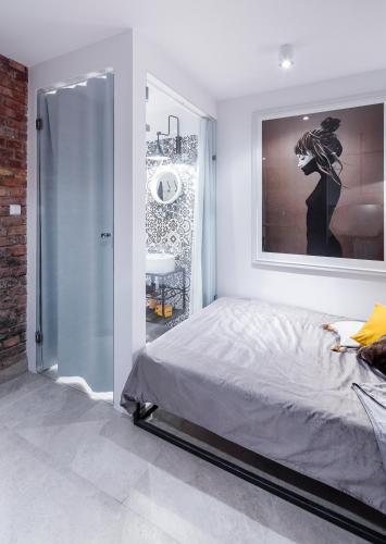 Łóżko lub łóżka w pokoju w obiekcie Business&Relax Apartment