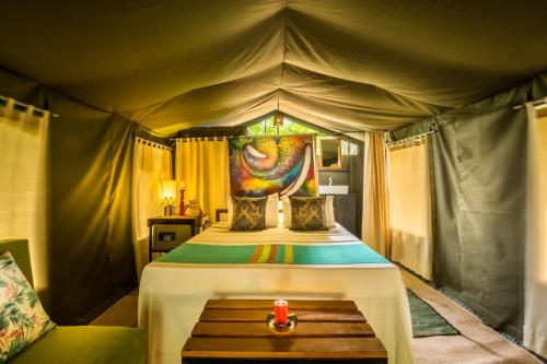 A bed or beds in a room at Mahoora - Yala by Eco Team - Level 1 Certified