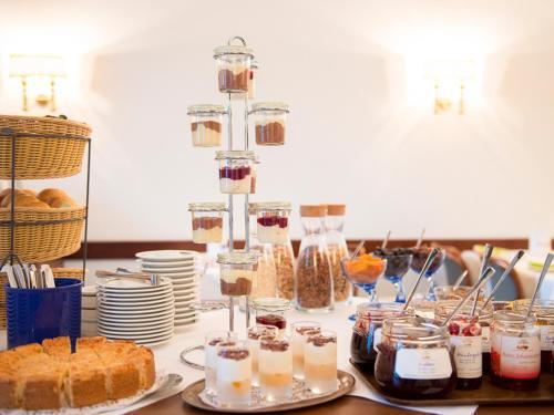 Restaurant ou autre lieu de restauration dans l'établissement Hotel Axel Springer