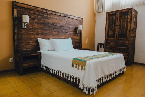 A bed or beds in a room at La Fe Hotel and Arts