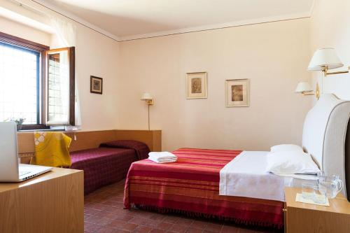 A bed or beds in a room at Agriturismo Valle Galfina