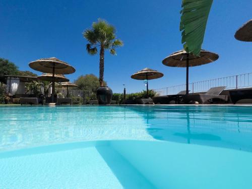 The swimming pool at or near Boutique Hotel Su Sergenti