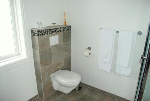 A bathroom at Grand Guesthouse Gardakot