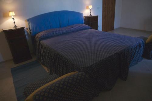 Letto o letti in una camera di Masseria Rosario
