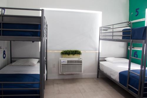 A bunk bed or bunk beds in a room at Miami Beach International Hostel