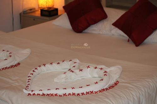 A bed or beds in a room at Rasdhoo Coralville
