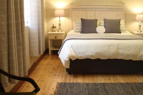 A bed or beds in a room at Ripple Hill Hotel