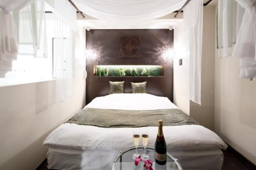 A bed or beds in a room at Hotel The Lotus Bali (Adult Only)