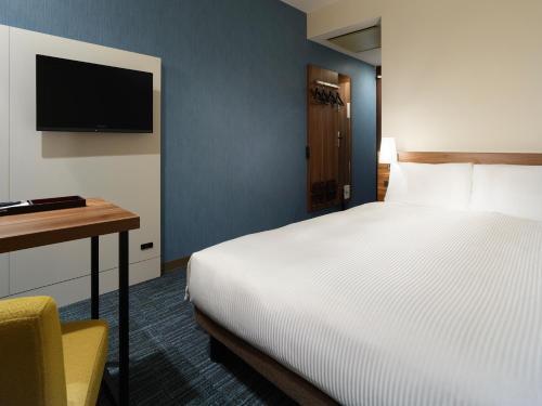 熊本三井花園酒店房間的床