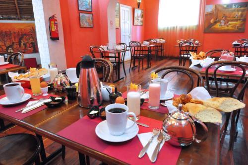 Restaurant ou autre lieu de restauration dans l'établissement Rova Hotel
