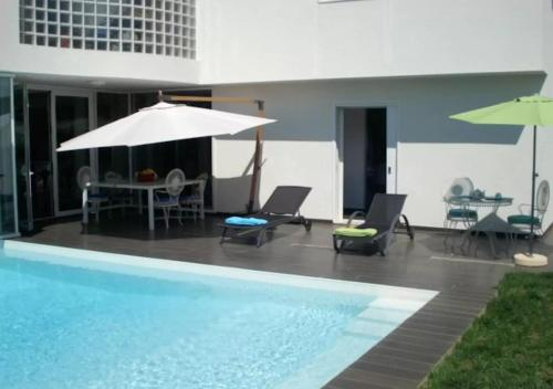 The swimming pool at or near Tavira Great Suite with Pool