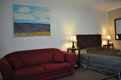 A bed or beds in a room at Augusta Courtyard Motel