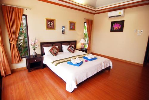 A bed or beds in a room at Lanta Ilmare Beach Resort