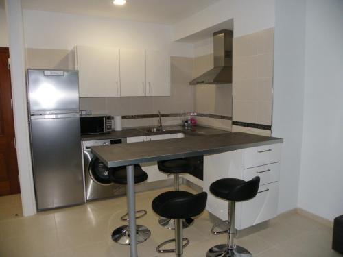 Una cocina o zona de cocina en Apartamento en Bajamar Tenerife