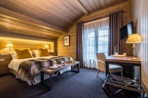 Кровать или кровати в номере Hotel Le Samoyede