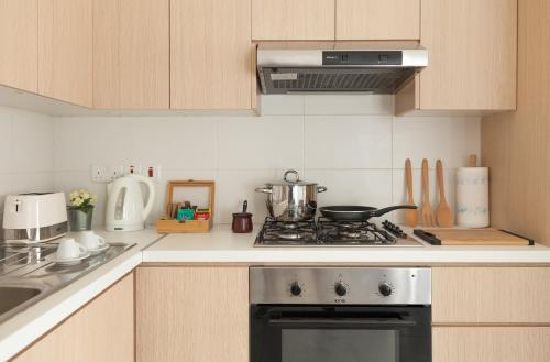 A kitchen or kitchenette at Myrtiana Apartments