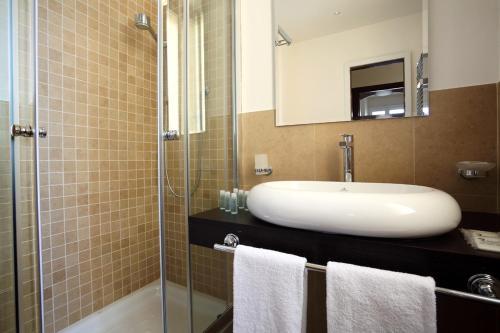 A bathroom at Trianon Borgo Pio Aparthotel