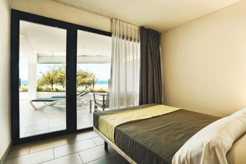 Een bed of bedden in een kamer bij Pins Platja