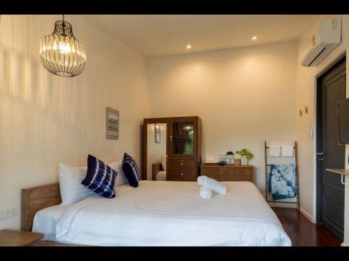 Ein Bett oder Betten in einem Zimmer der Unterkunft 18 In Town Homestay