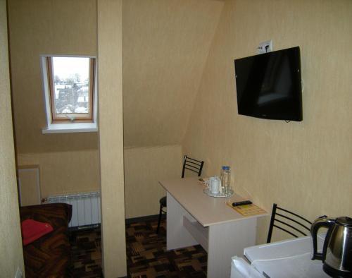 Телевизор и/или развлекательный центр в Отель Олимп