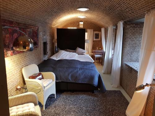 Een bed of bedden in een kamer bij Kazemat Zus