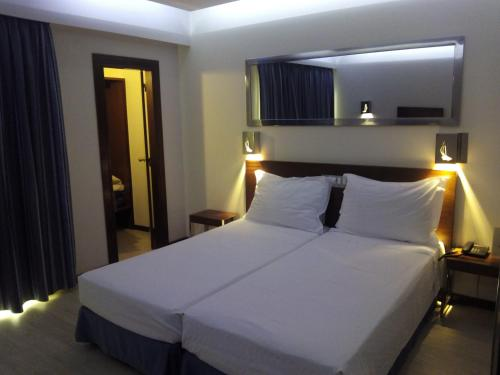 A bed or beds in a room at Alisios