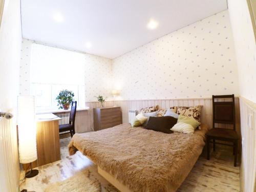 Кровать или кровати в номере Apartments near Kremlin