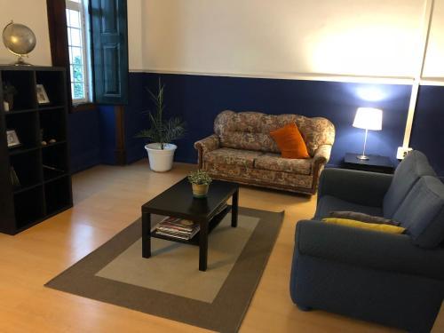 Uma área de estar em Le Penguin Hostel