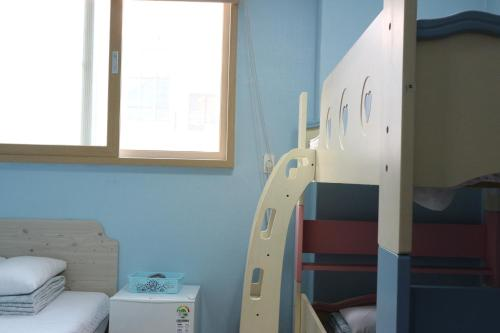 A bunk bed or bunk beds in a room at Well Plus Guest House