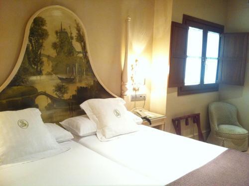 A bed or beds in a room at Sacristia de Santa Ana