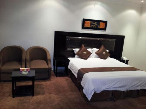 Cama ou camas em um quarto em Dorar Darea Hotel Apartments - Al Malqa