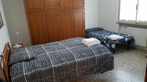 A bed or beds in a room at B&B Terry e Fiammi