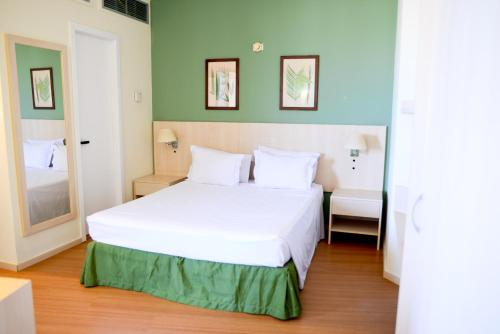 A bed or beds in a room at Rede Concept - Hotel Salvador