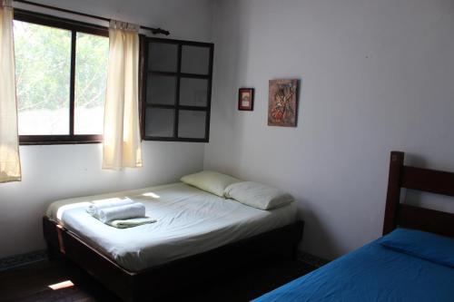 A bed or beds in a room at El Jardín de Playas