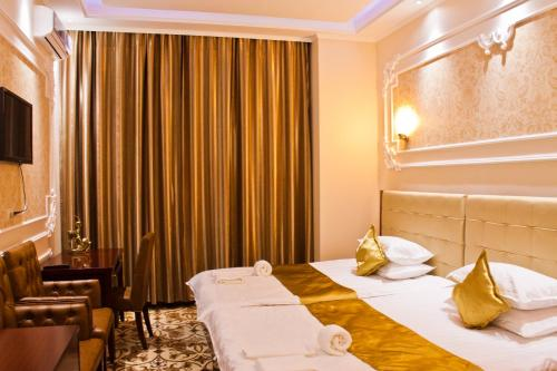 A bed or beds in a room at Sky Luxe Hotel