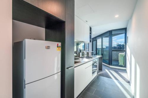 A kitchen or kitchenette at Astrina Garden View 2 Bedroom