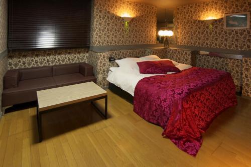 ホテル ココパーム (レジャーホテル)にあるベッド